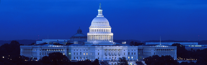 Image of the United State Congressional building lit in the early evening.
